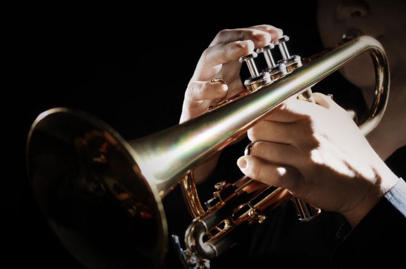 woman playing cornet